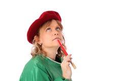 Χρωματίζοντας γυναίκα στο καπέλο και την πράσινη κάλυψη Στοκ Εικόνα
