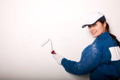 χρωματίζοντας γυναίκα τοίχων Στοκ Εικόνα