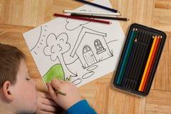 χρωματίζοντας νεολαίες πατωμάτων αγοριών Στοκ φωτογραφίες με δικαίωμα ελεύθερης χρήσης