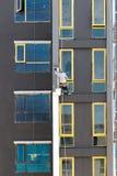 Χρωματισμένα ζωγράφοι κτήρια εργατών οικοδομών, κατοικημένα γεια Στοκ εικόνα με δικαίωμα ελεύθερης χρήσης