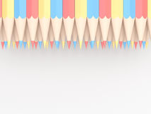 Χρωματισμένα μολύβια κόκκινων μπλε και κίτρινου που τακτοποιείται στο σχέδιο στο wh Στοκ φωτογραφία με δικαίωμα ελεύθερης χρήσης
