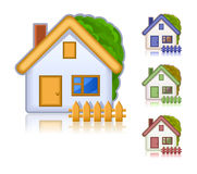 χρωματισμένα σπίτια που τίθ Στοκ Εικόνες