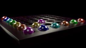 Χρωματισμένες σφαίρες στα κύτταρα στοκ εικόνα με δικαίωμα ελεύθερης χρήσης