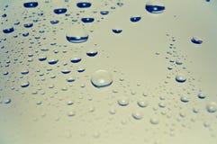 χρωματισμένη βροχή γυαλι&omic Στοκ Εικόνες