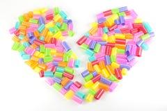 Χρωματισμένη μορφή καρδιών αχύρων κατανάλωσης Στοκ Εικόνες