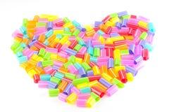 Χρωματισμένη μορφή καρδιών αχύρων κατανάλωσης Στοκ Φωτογραφία