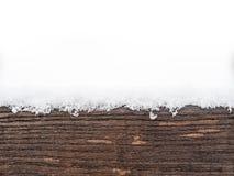 Χρωματισμένη ξύλινη πίνακας ή ξυλεία που καλύπτεται με το χιόνι Στοκ εικόνα με δικαίωμα ελεύθερης χρήσης