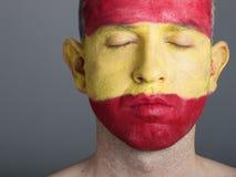 Χρωματισμένη πρόσωπο σημαία Ισπανία, ιδιαίτερες προσοχές ατόμων. Στοκ φωτογραφία με δικαίωμα ελεύθερης χρήσης