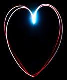 Χρωματισμένη φως καρδιά παγώματος στο Μαύρο Στοκ Φωτογραφίες