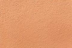 Χρωματισμένος τερακότα τοίχος στόκων Στοκ Εικόνες
