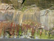 χρωματισμένο απότομος βράχος πρόσωπο Στοκ Εικόνα