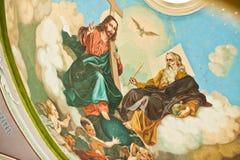 Χρωματισμένο εικονίδιο του Ιησούς Χριστού με το Λόρδο στον τοίχο στην εκκλησία Στοκ Εικόνα
