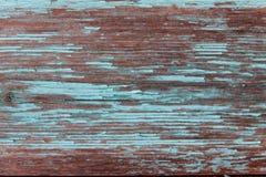 Χρωματισμένο ξύλινο υπόβαθρο με το ξεφλούδισμα του παλαιού χρώματος Στοκ Εικόνες