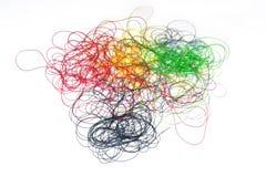 Χρωματισμένο ράβοντας νήμα στοκ εικόνα