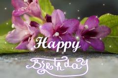 ΧΡΌΝΙΑ ΠΟΛΛΆ εγγραφή χεριών στενό λουλούδι επάνω στοκ εικόνα