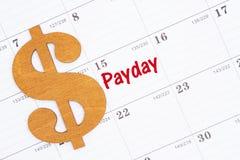 Χρόνος για payday σε ένα ημερολόγιο με ένα χρυσό σημάδι δολαρίων στοκ φωτογραφία με δικαίωμα ελεύθερης χρήσης