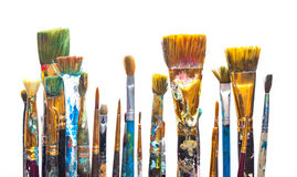 Χρώματα και βούρτσες στην άσπρη ανασκόπηση Στοκ Εικόνα
