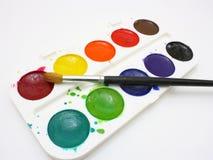 Χρώματα με τις βούρτσες Στοκ Φωτογραφία