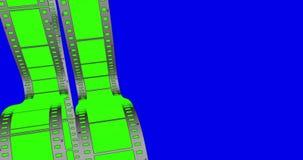 Χρώματος βασικό πράσινο οθόνης να τυλίξει λουρίδων κινηματογράφων ταινιών κάθετο στο μπλε υπόβαθρο χρώματος, άνευ ραφής απεικόνιση αποθεμάτων