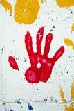 χρώμα το κόκκινο s παιδιών handprint Στοκ Φωτογραφίες