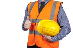 Χτίζοντας επιθεωρητής στην πορτοκαλιά φανέλλα διαφάνειας που δίνει τους αντίχειρες επάνω Στοκ Φωτογραφία
