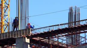 Χτίζοντας εργοτάξιο οικοδομής και εργαζόμενος Στοκ Εικόνα