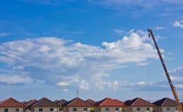 χτίζοντας σπίτι γερανών Στοκ Φωτογραφία