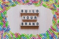Χτίστε την έννοια λέξεων εμπορικών σημάτων σας στοκ φωτογραφία