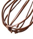 Χτυπήστε ελαφρά με τη λειωμένη σοκολάτα πέρα από το λευκό Στοκ Εικόνες