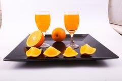 Χυμός από πορτοκάλι με τις φέτες του πορτοκαλιού Στοκ Εικόνες