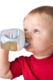 χυμός κατανάλωσης μπουκαλιών μωρών Στοκ Εικόνες