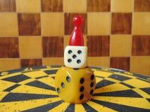 Χωρίστε σε τετράγωνα τον πύργο με τον αριθμό παιχνιδιού για την κορυφή με το υπόβαθρο πινάκων σκακιού Στοκ Φωτογραφία