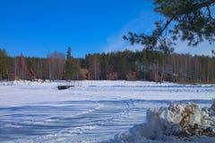 Χωριό στο χειμερινό δάσος Στοκ φωτογραφία με δικαίωμα ελεύθερης χρήσης