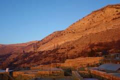 Χωριό της Dana κατά τη διάρκεια του ηλιοβασιλέματος στην επιφύλαξη φύσης βιοποικιλότητας της Dana στην Ιορδανία, Μέση Ανατολή στοκ εικόνες