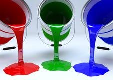 Χύνοντας κόκκινο, πράσινο και μπλε χρώμα Στοκ Εικόνες