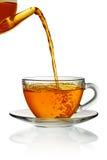 χύνοντας τσάι γυαλιού φλ&upsi Στοκ Εικόνα