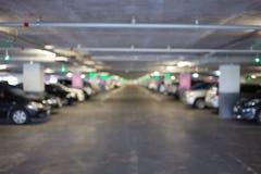 Χώρος στάθμευσης θαμπάδων με τα αυτοκίνητα Στοκ φωτογραφία με δικαίωμα ελεύθερης χρήσης
