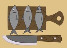Ψάρια σε έναν τέμνοντα πίνακα Στοκ Φωτογραφίες