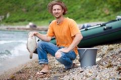 Ψαράς με τους πλευρονήκτες στο χέρι του Στοκ Εικόνες