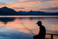 Ψαράς σκιαγραφιών Στοκ Εικόνες