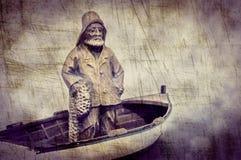 Ψαράς στη βάρκα του στοκ εικόνα