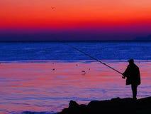 Ψαράς στο ηλιοβασίλεμα Στοκ εικόνα με δικαίωμα ελεύθερης χρήσης