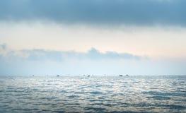 Ψαράδες στις βάρκες στην ανατολή Στοκ Εικόνα