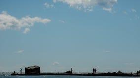 Ψαράδες φωτογραφίας χρώματος στην αποβάθρα Στοκ Φωτογραφίες