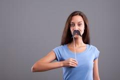 Ψευδές χαμόγελο κοριτσιών mustache Στοκ φωτογραφίες με δικαίωμα ελεύθερης χρήσης