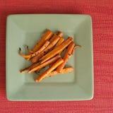 Ψημένα καρότα με το ελαιόλαδο σκόρδου και Στοκ εικόνες με δικαίωμα ελεύθερης χρήσης