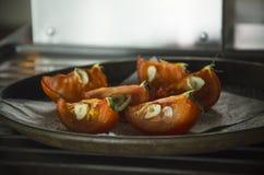 Ψημένες ντομάτες με το σκόρδο Στοκ φωτογραφία με δικαίωμα ελεύθερης χρήσης