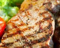 ψημένη στη σχάρα βόειο κρέας μπριζόλα Στοκ φωτογραφία με δικαίωμα ελεύθερης χρήσης