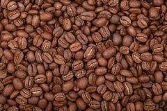 Ψημένη Arabica τοπ άποψη υποβάθρου φασολιών καφέ Στοκ Εικόνες