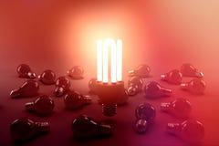 Ψηφιακή σύνθετη εικόνα του φωτισμένου ενεργειακού αποδοτικού lightbulb πέρα από τους βολβούς Στοκ Φωτογραφίες